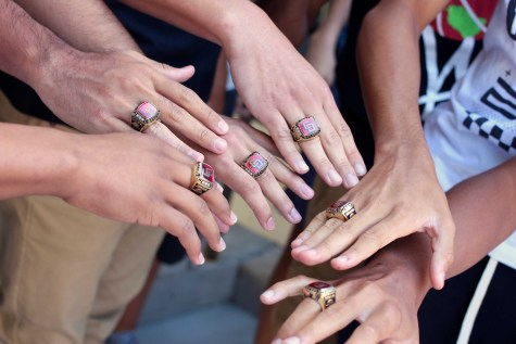The varsity boys compare their custom-made rings, which are produced by the same company that produces Super Bowl rings.