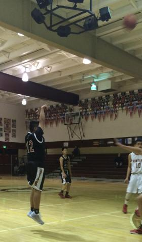 Sophomore Jake Longoria shoots a deep 3-pointer, one of three in the game against Vintage.