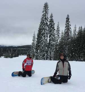 Junior Aidan Cunningham (left) and his father, Andy, prepare for the snowboard race, at Mount Shasta March 9.
