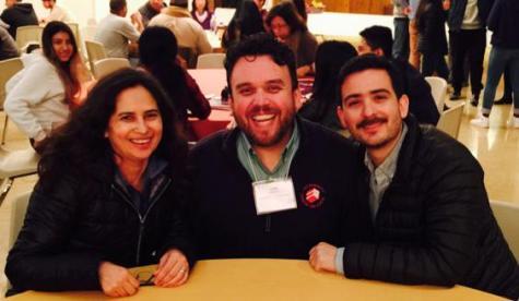 Spanish teacher Patricia Portillo and Breakthrough director Adolfo Mercado meet with a fellow student adviser.