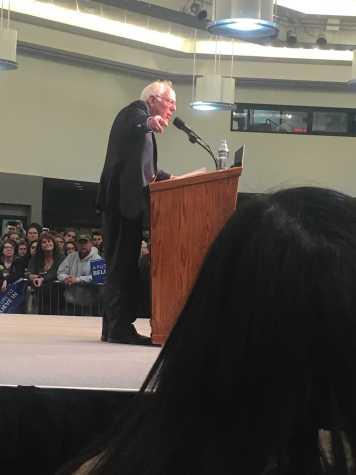 Sanders speaks within Mathisen's direct view.