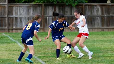 In a match against Western Sierra on April 19, junior Natalie Brown scuffles with a defensive player.