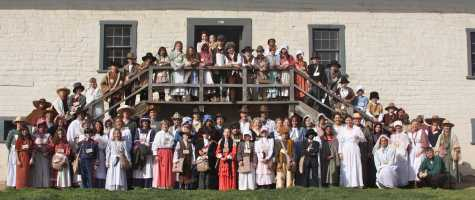 The fourth-grade class and parent volunteers take their annual picture outside of the fort's historical main office.