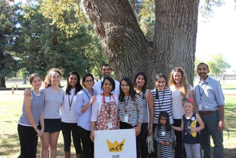 Junior Sahej Claire (third from the left) with her aunt, Raj Sanghvi (center in striped and polka-dot shirt) and Abhi's twin sister, Sofiya (front row striped dress), stand with other volunteers at last year's Art for Abhi.