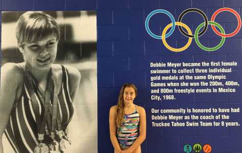 Freshman Rebecca Waterson stands in front of a wall that features her former coach, Olympic medalist Debbie Meyer, at the new Truckee Aquatic Center.