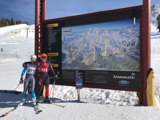 Team captain junior Luca Procida and freshman Colin Ursey next to the Mammoth Mountain map. (Photo used by permission of Christy Procida)