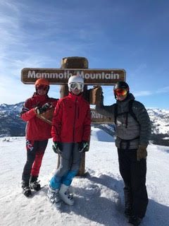(From left to right) Freshman Colin Ursey, team captain junior Luca Procida and coach Jason Kreps stand near the Mammoth Mountain sign. Team captain junior Luca Procida and freshman Colin Ursey next to the Mammoth Mountain map. (Photo used by permission of Christy Procida)