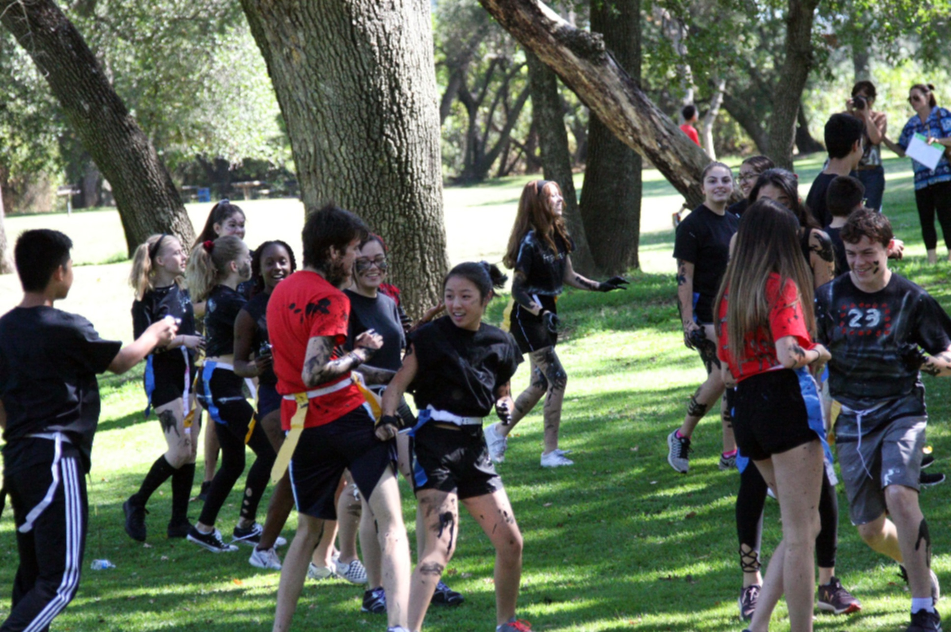 Members of the Black Team attack the Red Team with paint. (Photo by Shimin Zhang)