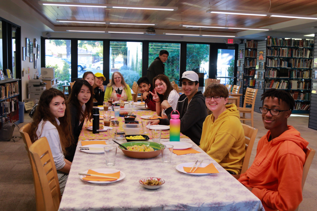 Librarian Joanne Melinson's advisory eats breakfast during the time allotted for advisory activities. (Photo by Hermione Xian)