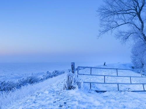 Dike along frozen ?sselmeer, Netherlands
