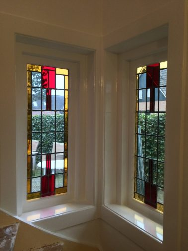 Glas in lood raam geschilderd