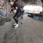 Jason slalom on his skateboard
