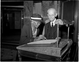 Fay watches Adeline Jenkins, 99, sign the tomb guest register, Sept. 21, 1947. Jenkins had been at the tomb to attend an observance of the 84th anniversary of the signing by Lincoln of the Emancipation Proclamation. Photo from: http://www.sj-r.com/article/20100211/Blogs/302119936