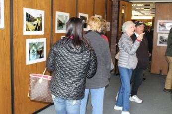 Visitors at John Frey's exhibition of Crestwood Mall photos, March 11, 2017