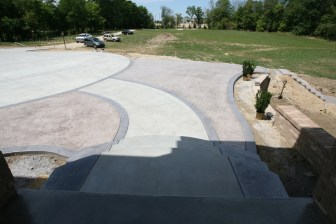 Plain concrete walkway with Roman Slate surround