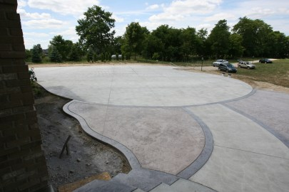 Plain concrete walkway with Roman Slate surround