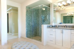 Large Bathroom with White Cabinets and Green Tiles Bathroom remodeling