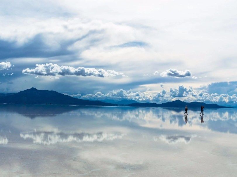 during-the-wet-season-the-salar-de-uyuni-salt-flats-in-bolivia-are-covered-in-a-thin-layer-of-water-creating-surreal-reflections-of-the-sky