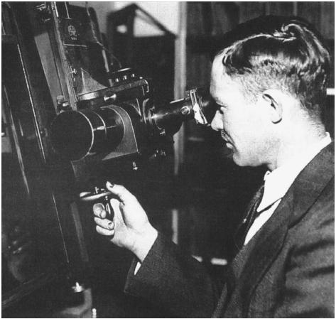 Clyde Tombaugh searches for Pluto at the Lowell Observatory in 1930.