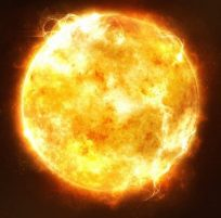 Bright and hot orange sun on a black space background