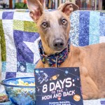 "Kuiper poses with the DVD of ""8 Days to the Moon and Back"" and a bowl of popcorn."