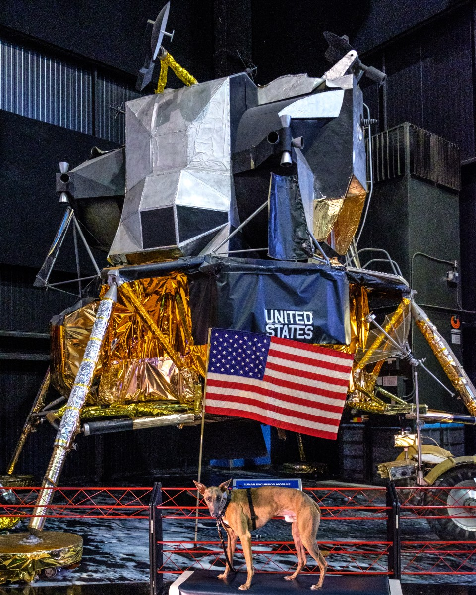 Kuiper poses with a full scale lunar module.