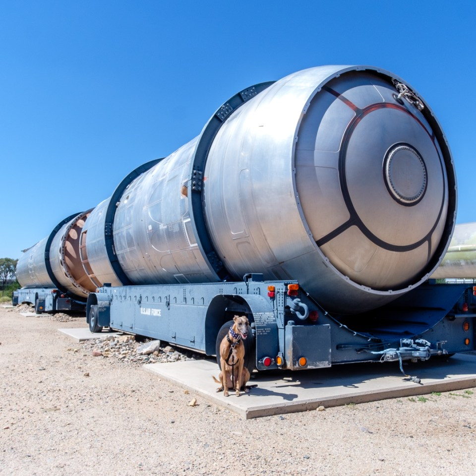 Kuiper poses with the middle section of a Titan II rocket.