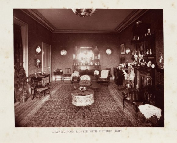 Victorian drawing room with electric lights