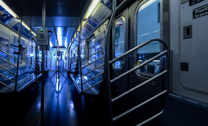 New York subway train car with blue UV lights