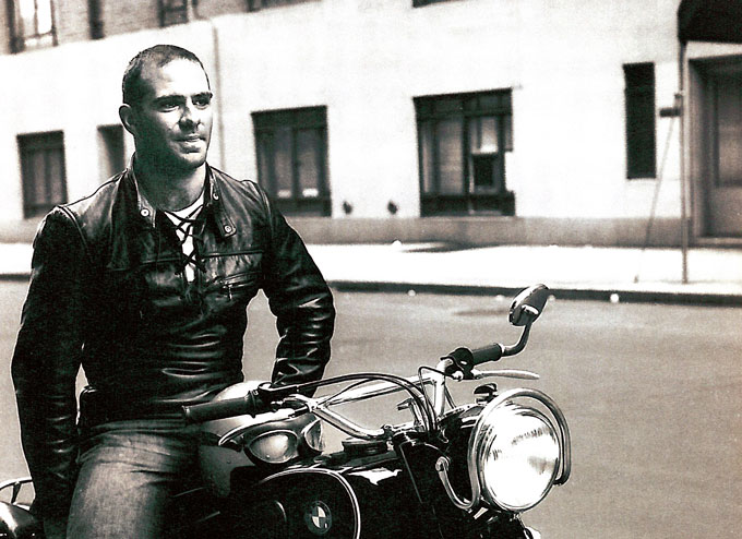 black and white image of Oliver Sacks sitting on a motorcycle