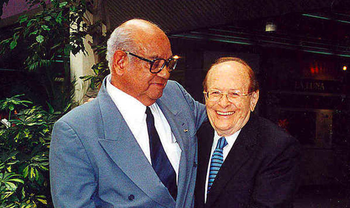 Luis Miramontes stands with George Rosenkranz