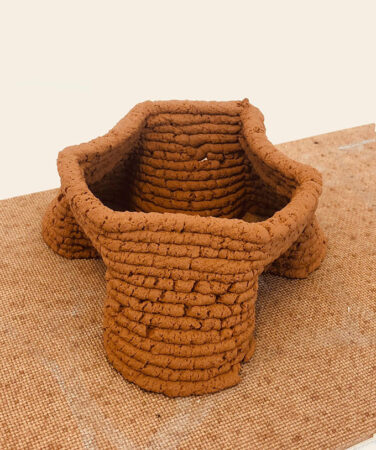 a small structure 3D printed using a soil based material