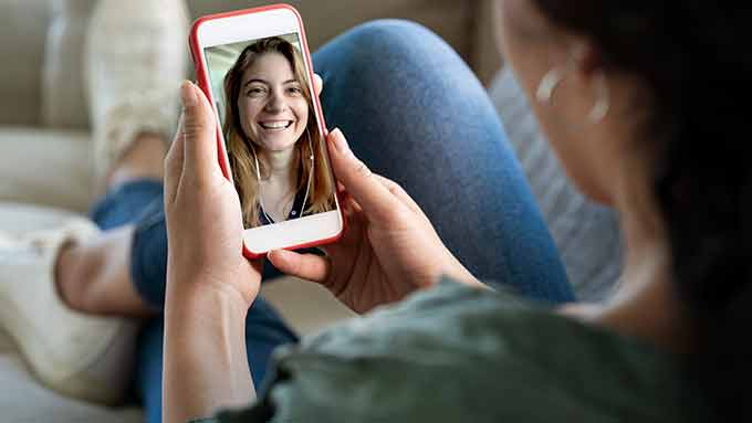 a girl video chatting with a friend