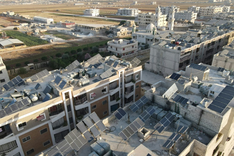 Aerial view of the roofs of the city of Al-Dan, covered with solar panels, in Idleb in northwestern Syria, June 10, 2021 (AFP - Aaref WATAD)