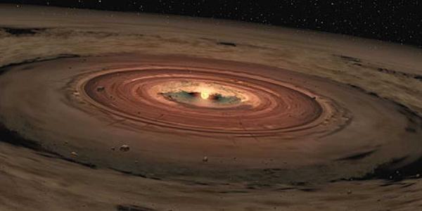De zon in het hart van de stof- en gaswolk waarin deze ontstond. Afbeelding: NASA.