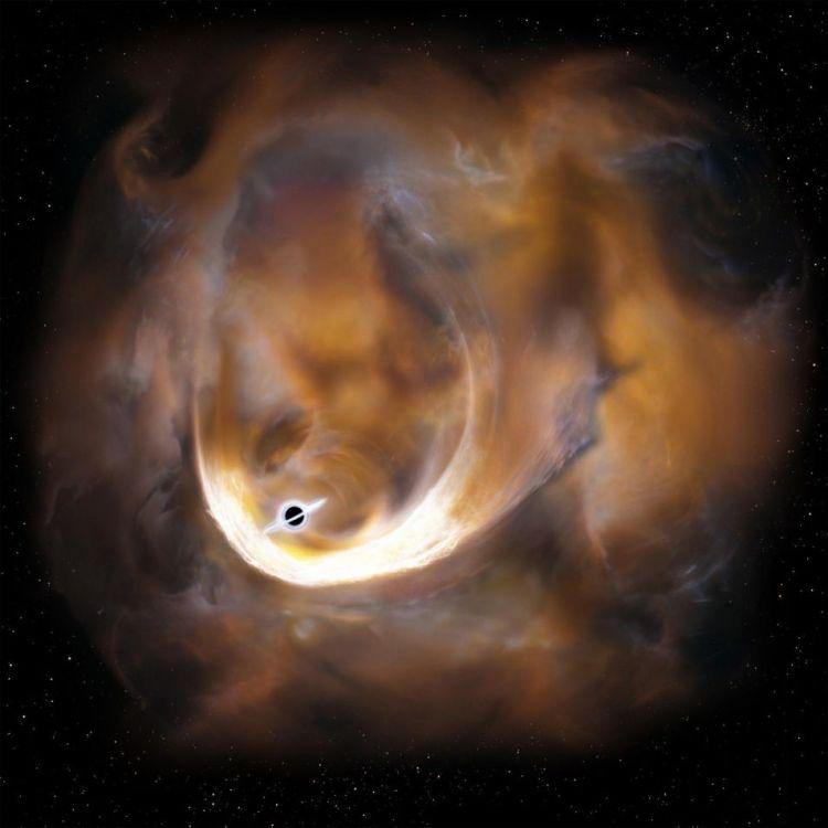 De grote snelheidsdispersie is niet te verklaren door bijvoorbeeld de aanwezigheid van een supernova, zo stellen de onderzoekers. Alle simulaties wijzen in de richting van één veroorzaker: een middelzwaar zwart gat. Wanneer gas in de buurt van het zwarte gat komt, krijgt het haast, wanneer het voorbij het zwarte gat is, vertraagt het. Afbeelding: Keio University.