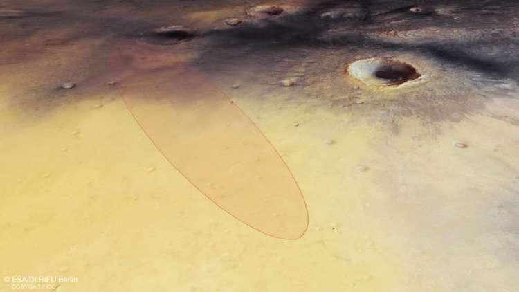 In het omcirkelde gebied moet Schiaparelli neerkomen. Eerder landde NASA's Marsrover Opportunity al in dit gebied. Afbeelding: ESA / DLR / FU Berlin.