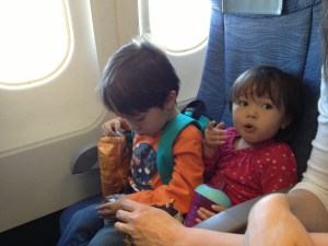 My kids snacking in-flight.