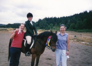 My mom & dad with my sister who'd just won another dressage ribbon