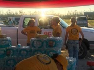 Scientology volunteers loading supplies