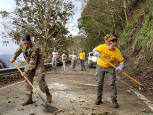 Working alongside the army to clear debris from a road in Puerto Rico