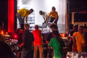 Scientology Volunteer Ministers Unloading Disaster Relief Supplies