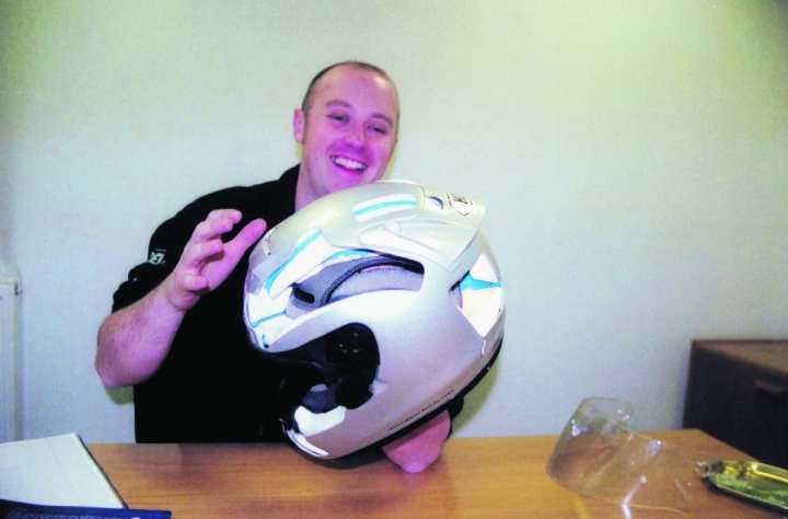 Using this cutaway Shoei X-Spirit, Rob shows the various parts that a crash helmet consists of, including the outer shell, EPS Iiner, visor, comfort padding, and the ventilation flow marked in blue.