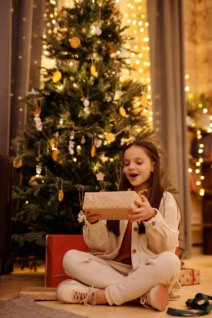 girl looking excited from her christmas gift