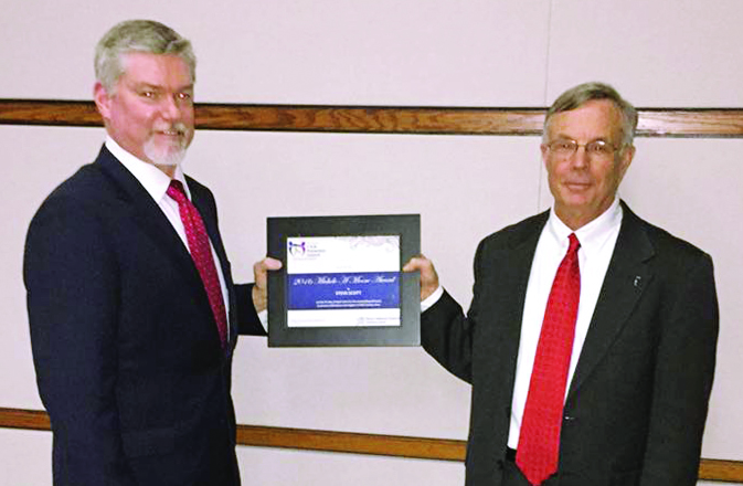 Steve receiving the Michele A. Moore Award