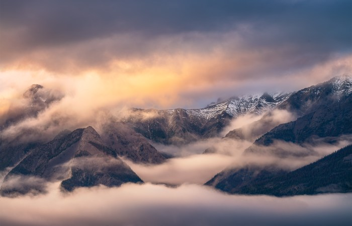 Landscape Photography of dramatic sunset light hitting mountain peaks in the Canadian Rockies in Jasper National Park, Alberta