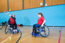 Two girls playing wheelchair tennis