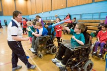 Shona Malcolm from Scottish Athletics coaching young wheelchair user in javelin throwing