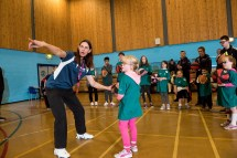 Tina Gordon from basketball Scotland coaching green team in basketball drills