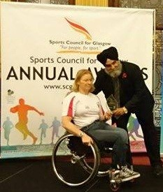 Sarah Baillie receiving Disability Coach of the Year award